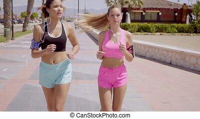 sportif, deux, jeune, jogging, dehors, femmes