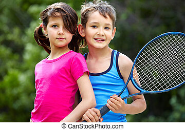 Sportive couple - Portrait of a little girl and boy with ...