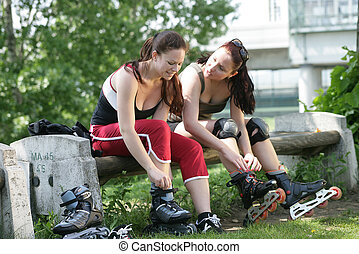 sportive friends sitting on a bench