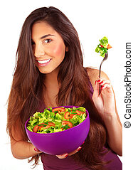 Sportive girl eating fresh salad