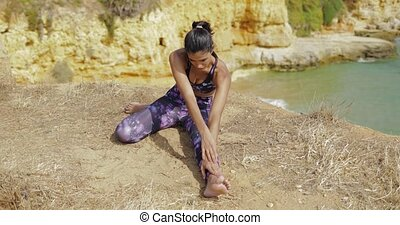 Sportive girl training on shoreline - Concentrated young...