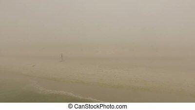 Sportive Girl Turns Around on a Sandy Beach of Dzharylhach Island