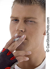 sportive guy smoking on an isolated background