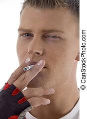 sportive guy smoking