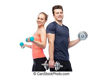 sportive, herre och kvinna, med, hantlar