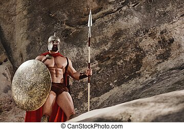 Sportive man in ancient warrior armor