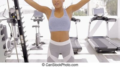 Sportive model training in gym - Young ethnic woman wearing...