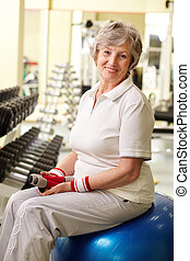 Sportive senior - Portrait of senior woman looking at camera...