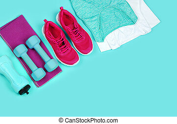 Sportive still life with a text space on teal color background
