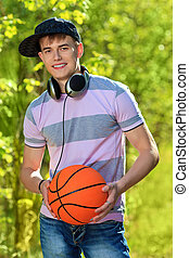 sportive teen - Portrait of a young man student outdoors.