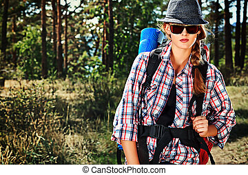 Beautiful girl tourist walking the trekking trail.