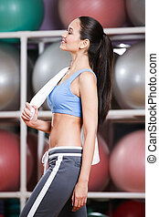 Sportive woman in tracksuit in fitness gym