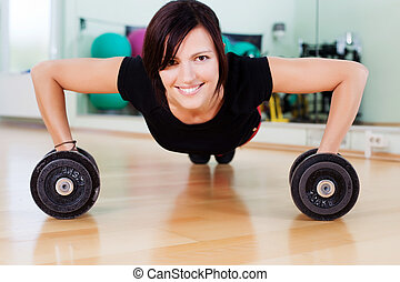 Sportive woman - Very sportive woman doing pushups with...