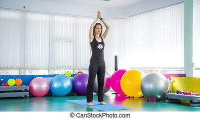Sportive Woman Taking Chair Pose In The Gym