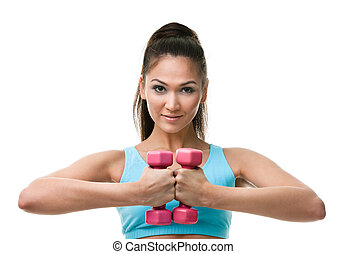 Sportive woman works out with weights