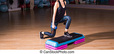 Sportive young woman with beautiful athletic body doing exercises with dumbbells close-up. Fitness, bodybuilding. Healthcare