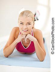 sportliche , frau, machen, übung, boden