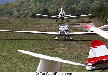 sports airplanes on an airfield