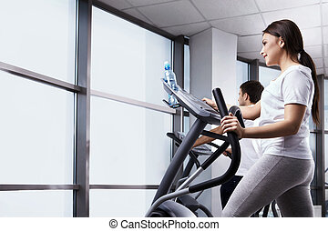 Sports are health - The nice girl is engaged in fitness club
