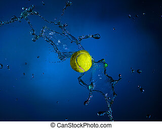 Sports ball and splashes of water on a blue background