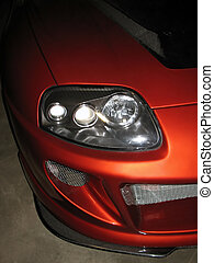 sports car detail - front headlight, hood, and front fascia...