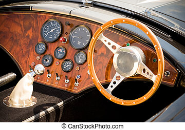 interior and dashboard detail of a beautifully restored retro soft-top sports car