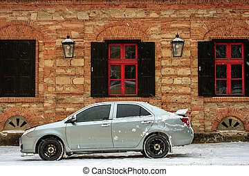sports car near the old building in winter - sports car...