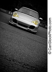 Sports Car With Copyspace - A silver sports car with the...