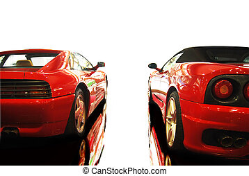Sports Cars -  shot  of a two red sports cars (ferrari)