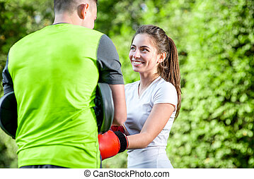 Sports couple in the park - Young sports couple training to...