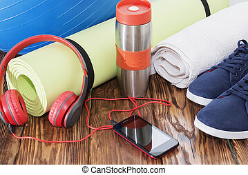 Sports equipment, Fit ball, yoga mat, and water bottle close up.