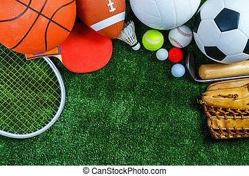 Sports Equipment on green grass, Top view