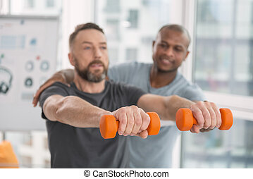 Selective focus of orange dumbbells