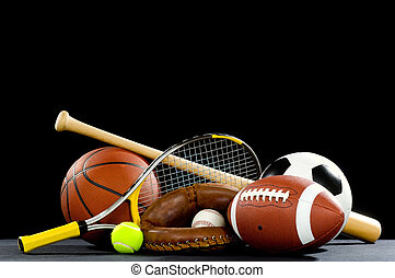 Sports Equipment - A variety of sports equipment on a black...