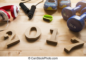 Sports equipment with 2017 numbers on wooden background