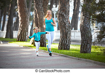 sports family mother and child daughter are engaged in...