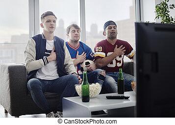 Sports fan singing their national anthem