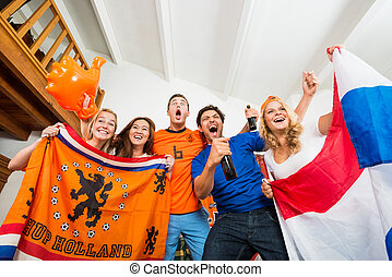 Sports fans excitement - Excited young multiethnic soccer...