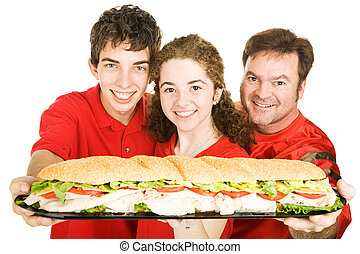 Sports Fans With Giant Sandwich - Football fans holding a...