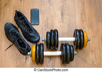 Gym equipment on wooden background
