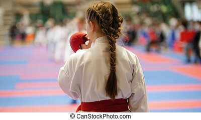 Sports girl teenager wears a mouthguard - female sportsmen on karate - ready for fight