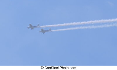 Sports gliders show acrobatics on the air show. Sunny day,...