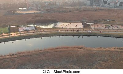 Sports ground park aerial drone view on sunset