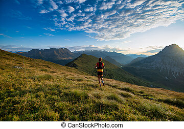 Sports in nature run during the sunrise in the mountains
