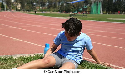Sports injuries of young boy outdoors