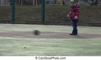Sports Kid. Girl Playing Football. Baby with Ball on Sports Field.