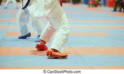 Sports kids - female sportsmen on karate, close up