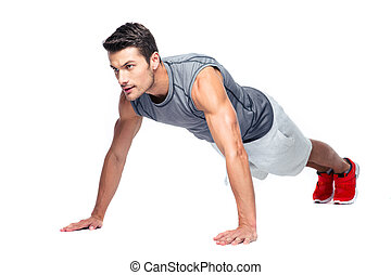 Sports man doing push ups