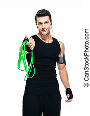 Sports man holding skipping rope