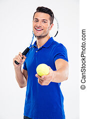 Sports man holding tennis racket and ball